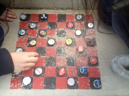 Playing Checkers on a board painted on the playground Flipped Playground Outdoor Learning
